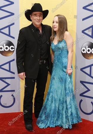Clint Black (L) arrives at the 2016 Country Music Awards at Bridgestone Arena in Nashville, Tennessee on November 2, 2016.