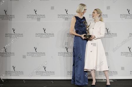 Maria Rorbye Ronn and Birgitte Hjort Sorensen hold an Emmy Award in the press room at the 44th International Emmy Awards at the New York Hilton in New York City on November 21, 2016.