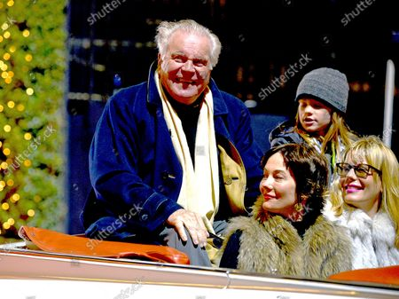 Robert Wagner (L) and his family ride down Hollywood Boulevard during the 85th Annual Hollywood Christmas Parade on Hollywood Boulevard in Los Angeles, California on November 27, 2016.