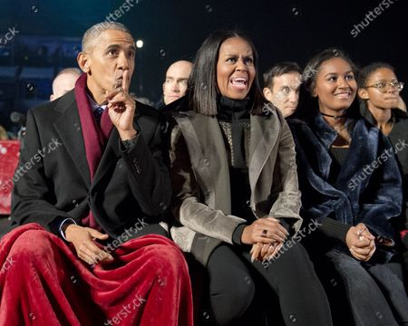 United States President Barack Obama, first lady Michelle Obama and Sasha Obama watch the entertainment as they attend the National Christmas Tree Lighting Ceremony on the Ellipse in Washington, DC on Thursday, December 1, 2016.