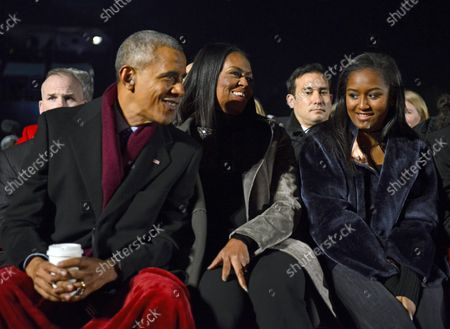 United States President Barack Obama, first lady Michelle Obama, and Sasha Obama listen to the performances as they attend the National Christmas Tree Lighting on the Ellipse in Washington, DC on Thursday, December 1, 2016.