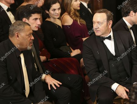 Actor Kevin Spacey (L) and actor Laurence Fishburne (L) wait for the beginning of an event for the 2016 Kennedy Center Honorees, in the East Room of the White House, December 4, 2016. The honorees include pianist Martha Argerich, actor Al Pacino, singer Mavis Staples, singer James Taylor and Eagles band members Don Henley, Timothy B. Schmit, Joe Walsh.