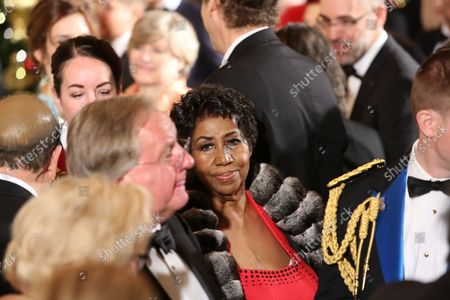 Singer Aretha Franklin leaves the East Room after attending an event for the 2016 Kennedy Center Honorees, in the East Room of the White House, December 4, 2016. The honorees include pianist Martha Argerich, actor Al Pacino, singer Mavis Staples, singer James Taylor and Eagles band members Don Henley, Timothy B. Schmit, Joe Walsh.