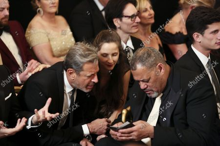 Actor Jeff Goldblum (L), his wife Emily Goldblum and actor Laurence Fishbone, wait for the beginning of an event for the 2016 Kennedy Center Honorees, in the East Room of the White House, December 4, 2016. The honorees include pianist Martha Argerich, actor Al Pacino, singer Mavis Staples, singer James Taylor and Eagles band members Don Henley, Timothy B. Schmit, Joe Walsh.