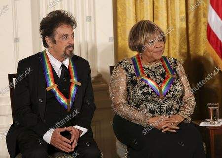 Actor Al Pacino, and singer Mavis Staples listen to Us President Barack Obama during a ceremony for 2016 Kennedy Center Honorees, in the East Room of the White House, December 4, 2016, Washington, DC. Other honorees include pianist Martha Argerich,  singer James Taylor and Eagles band members Don Henley, Timothy B. Schmit, Joe Walsh.