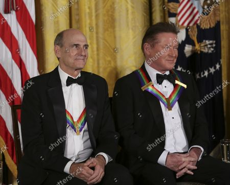 Singer James Taylor and Eagles band member Don Henley listen to Us President Barack Obama during a ceremony for 2016 Kennedy Center Honorees, in the East Room of the White House, December 4, 2016, Washington, DC. Other honorees include pianist Martha Argerich, actor Al Pacino, singer Mavis Staples and Eagles band members Timothy B. Schmit, and Joe Walsh.