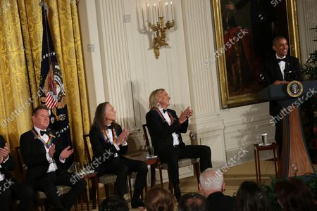 President Barack Obama jokes with the band members of the group Eagles (L-R) Don Henley, Timothy B. Schmit, Joe Walsh, 2016 Kennedy Center Honorees, in the East Room of the White House, December 4, 2016. The honorees include pianist Martha Argerich, actor Al Pacino, singer Mavis Staples, singer James Taylor and Eagles band members Don Henley, Timothy B. Schmit, Joe Walsh.