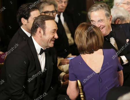 Actor Kevin Spacey (L) and representative Nancy Pelosi (R) wait for the beginning of an event for the 2016 Kennedy Center Honorees, in the East Room of the White House, December 4, 2016. The honorees include pianist Martha Argerich, actor Al Pacino, singer Mavis Staples, singer James Taylor and Eagles band members Don Henley, Timothy B. Schmit, Joe Walsh