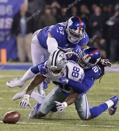New York Giants Keenan Robinson stands behind Janice Jenkins who hits Dallas Cowboys Dez Bryant and forces a fumble late in the 4th quarter in week 14 of the NFL at MetLife Stadium in East Rutherford, New Jersey on December 11, 2016. The Giants defeated the Cowboys 10-7.