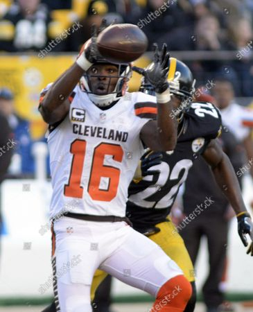 Cleveland Browns wide receiver Andrew Hawkins (16) gains nine yards on the catch with Pittsburgh Steelers cornerback William Gay (22) in coverage during overtime of the Steelers 27-24 win at Heinz Field in Pittsburgh on January 1, 2017.