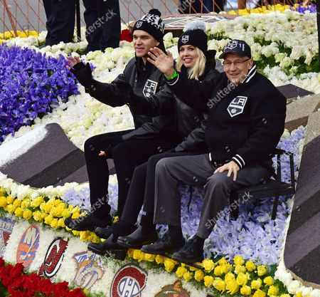 (L-R) LA Kings Hall of Famer Luc Robitaille and his wife Stacia and LA Kings Announcer Bob Miller ride on the National Hockey League (NHL) float as it makes its way down Colorado Boulevard in the 128th Rose Parade held in Pasadena, California on January 2, 2017.
