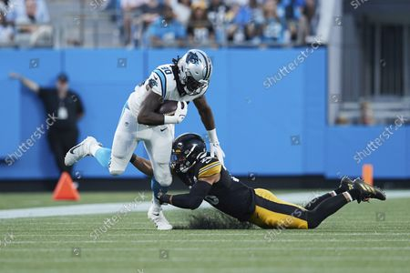Carolina Panthers tight end Ian Thomas (80) is hit by Pittsburgh Steelers linebacker Miles Killebrew (28) during an NFL preseason football game, in Charlotte, N.C