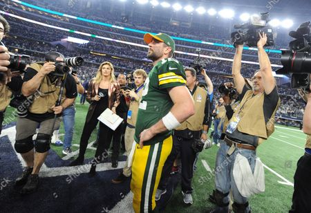 Green Bay Packers quaterback Aaron Rogers looks around the stadium after leading his team to a 34-31 victory over the Dallas Cowboys in the NFC divisional playoff game at AT&T Stadium in Arlington, Texas on January 15, 2017.  The Packers will face the Falcons in the NFC Championship.