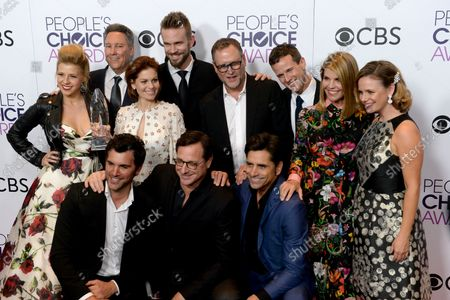 """(Back L-R) Actress Jodie Sweetin, producer Jeff Franklin, actors Candace Cameron Bure, John Brotherton, Dave Coulier, Scott Weinger, Lori Loughlin, Andrea Barber and (front L-R) actors Juan Pablo Di Pace, Bob Saget and John Stamos appear backstage with their award for Favorite Premium Comedy Series for """"Fuller House"""" during the 43rd annual People's Choice Awards at the Microsoft Theater in Los Angeles on January 18, 2017."""