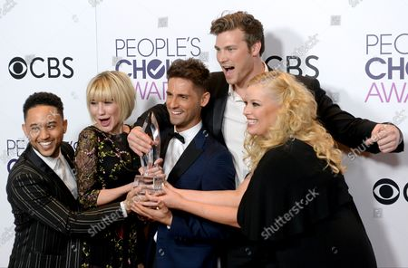 """(L-R) Actors Tahj Mowry, Chelsea Kane, Jean-Luc Bilodeau, Derek Theler and Melissa Peterman appear backstage with their award for Favorite Cable TV Comedy for """"Baby Daddy"""" during the 43rd annual People's Choice Awards at the Microsoft Theater in Los Angeles on January 18, 2017."""