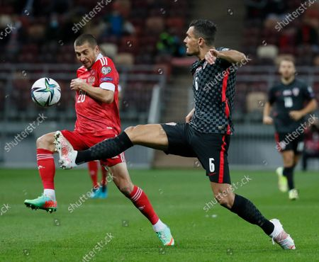 Dejan Lovren (R) of Croatia in action against Aleksei Ionov (L) of Russia during the FIFA World Cup 2022 Group H qualifying soccer match between Croatia and Russia in Moscow, Russia, 01 September 2021.