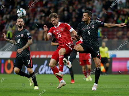 Marcelo Brozovic (L) and Dejan Lovren (R) of Croatia in action against Aleksei Miranchuk (C) of Russia during the FIFA World Cup 2022 Group H qualifying soccer match between Croatia and Russia in Moscow, Russia, 01 September 2021.