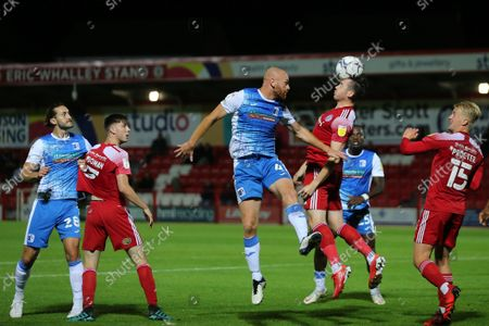 Jason Taylor of Barrow contests a header with Jack Nolan of Accrington Stanley during the EFL Trophy match between Accrington Stanley and Barrow at the Wham Stadium, Accrington on Tuesday 31st August 2021.