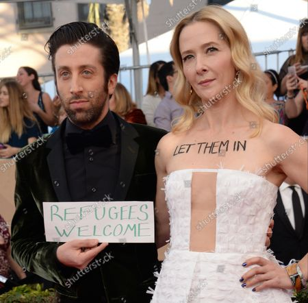 Actors Simon Helberg (L) and Jocelyn Towne arrive for the the 23rd annual SAG Awards held at the Shrine Auditorium in Los Angeles on January 29, 2017. The Screen Actors Guild Awards will be broadcast live on TNT and TBS.