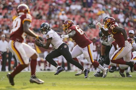Washington Football Team quarterback Kyle Allen (8) is sacked by Washington Football Team's David Bada during the first half of a preseason NFL football game, in Landover, Md. At right is Washington Football Team defensive end Jalen Jelks (57