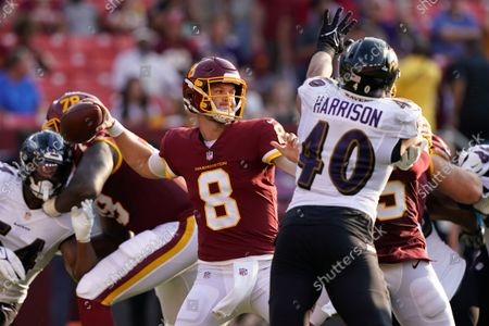 Washington Football Team quarterback Kyle Allen (8) throws during the first half of a preseason NFL football game against the Baltimore Ravens, in Landover, Md. At right is Baltimore Ravens linebacker Malik Harrison (40