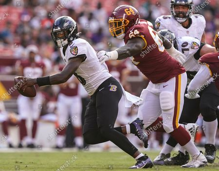 Washington Football Team quarterback Kyle Allen (8) is sacked by Washington Football Team's David Bada during the first half of a preseason NFL football game, in Landover, Md