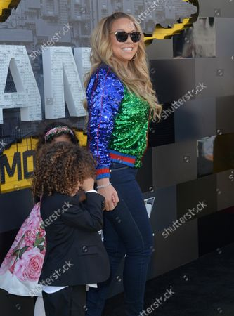 """Stock Picture of Singer-songwriter Mariah Carey arrives with her son Moroccan Scott Cannon (L) and daughter Monroe Cannon for the premiere of the animated fantasy """"The LEGO Batman Movie"""" at the Regency Village Theatre in the Westwood section of Los Angeles on February 4, 2017. Storyline: Bruce Wayne must not only deal with the criminals of Gotham City, but also the responsibility of raising a boy he adopted."""