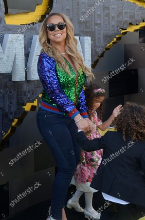 """Singer-songwriter Mariah Carey arrives with her son Moroccan Scott Cannon (L) and daughter Monroe Cannon for the premiere of the animated fantasy """"The LEGO Batman Movie"""" at the Regency Village Theatre in the Westwood section of Los Angeles on February 4, 2017. Storyline: Bruce Wayne must not only deal with the criminals of Gotham City, but also the responsibility of raising a boy he adopted."""