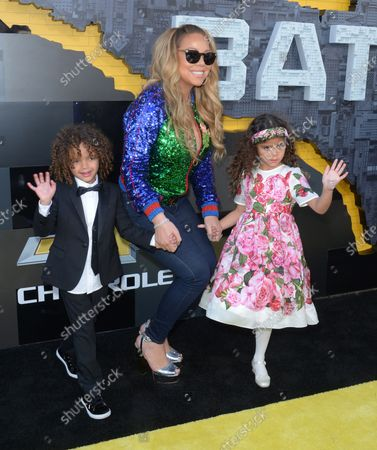"""Stock Photo of Singer-songwriter Mariah Carey arrives with her son Moroccan Scott Cannon (L) and daughter Monroe Cannon for the premiere of the animated fantasy """"The LEGO Batman Movie"""" at the Regency Village Theatre in the Westwood section of Los Angeles on February 4, 2017. Storyline: Bruce Wayne must not only deal with the criminals of Gotham City, but also the responsibility of raising a boy he adopted."""