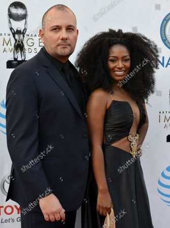Stock Picture of (L-R) Actors Stelio Savante and Jillian Reeves arrive for the 48th NAACP Image Awards at the Pasadena Civic Auditorium in Pasadena, California on February 11, 2017. The NAACP Image Awards celebrates the accomplishments of people of color in the fields of television, music, literature and film and also honors individuals or groups who promote social justice through creative endeavors.