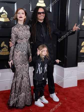 Stock Photo of (L-R) Actor Evis X. Shaffer, musician James 'Munky' Shaffer of Korn and D'Angelo Draxon Shaffer arrive for the 59th annual Grammy Awards held at Staples Center in Los Angeles on February 12, 2017.