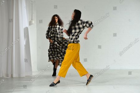 A model walks on the runway as a dancer performs at the Mara Hoffman fashion show at New York Fashion Week: The Shows at Shop Studios on February 13, 2017 in New York City.