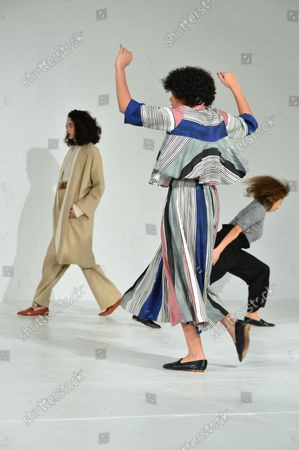 A model walks on the runway as dancers perform at the Mara Hoffman fashion show at New York Fashion Week: The Shows at Shop Studios on February 13, 2017 in New York City.