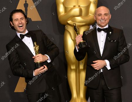 Director Alan Barillaro (L) and producer Marc Sondheimer, winners of the award for Short Film (Animated) for 'Piper', appear backstage during the 89th annual Academy Awards at Loews Hollywood Hotel in the Hollywood section of Los Angeles on February 26, 2017.