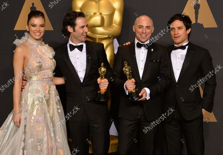 Director Alan Barillaro (2nd from L) and producer Marc Sondheimer (2nd from R), winners of the award for Short Film (Animated) for 'Piper', and presenters Hailee Steinfeld (L) and Gael Garcia Bernal appear backstage during the 89th annual Academy Awards at Loews Hollywood Hotel in the Hollywood section of Los Angeles on February 26, 2017.