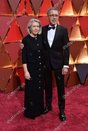 Production designer David Wasco (R) and set decorator Sandy Reynolds-Wasco arrive on the red carpet for the 89th annual Academy Awards at the Dolby Theatre in the Hollywood section of Los Angeles on February 26, 2017.