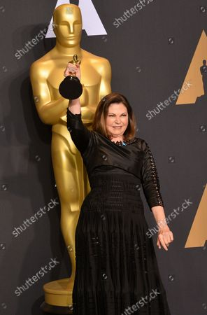 Costume designer Colleen Atwood (C), winner of the award for Costume Design for 'Fantastic Beasts and Where to Find Them,' appears backstage during the 89th annual Academy Awards at Loews Hollywood Hotel in the Hollywood section of Los Angeles on February 26, 2017.