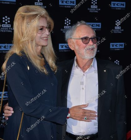 """Director Norman Jewison and his wife Lynne St. David attend the 50th anniversary screening of """"In the Heat of the Night"""" during opening night of the TCM Classic Film Festival at TCL Chinese Theatre in the Hollywood section of Los Angeles on April 6, 2017."""