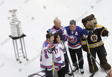 Retired New York Rangers Mark Messier and Mike Richter skate at The Rink At Rockefeller Center with the Stanley Cup and New York Islanders Pat LaFontaine on April 13, 2017 in New York City.