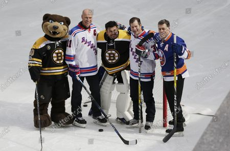 Retired New York Rangers Mark Messier and Mike Richter skate at The Rink At Rockefeller Center with the Stanley Cup, New York Islanders Pat LaFontaine and Boston Bruins Frank Brimsek on April 13, 2017 in New York City.