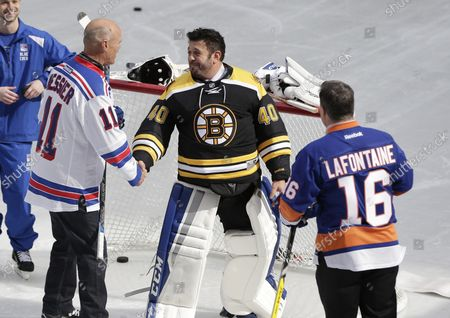 Retired New York Rangers Mark Messier skates at The Rink At Rockefeller Center with the Stanley Cup, New York Islanders Pat LaFontaine and Boston Bruins Frank Brimsek on April 13, 2017 in New York City.