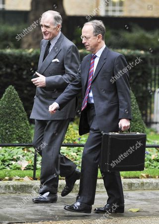 Stock Picture of Sir David Richards, chief of defence staff (right), walking with Air Chief Marshal Sir Jock Stirrup who is to quitting as head of the armed forces (l)