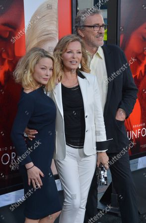 """Cast member Cheryl Ladd (C) and her husband Brian Russell and daughter Jordan Ladd attend the premiere of the motion picture dramatic thriller """"Unforgettable"""" at TCL Chinese Theatre in the Hollywood section of Los Angeles on April 18, 2017. Storyline: A woman sets out to make life hell for her ex-husband's new wife."""