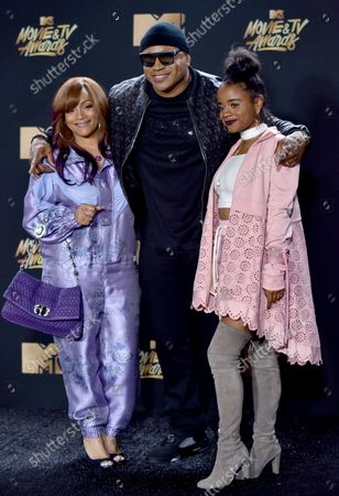 (L-R) Simone Smith, rapper LL Cool J, and Nina Simone Smith attend the MTV Movie & TV Awards at the Shrine Auditorium in Los Angeles on May 7, 2017. It will be the 26th edition of the awards, and will for the first time present honors for work in television as well as cinema.