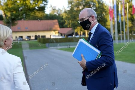 Ireland's Foreign Minister Simon Coveney arrives for a meeting of EU foreign ministers at the Brdo Congress Center in Kranj, Slovenia