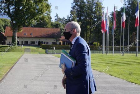 Ireland's Defense Minister Simon Coveney arrives for a meeting of EU defense ministers at the Brdo Congress Center in Kranj, Slovenia