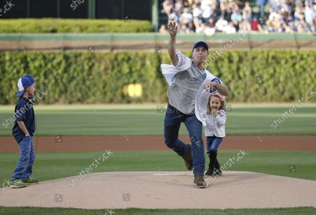 Actor David Eigenberg throws out a ceremonial first pitch before Chicago Cubs and Cincinnati Reds game at Wrigley Field on May 16, 2017 in Chicago.
