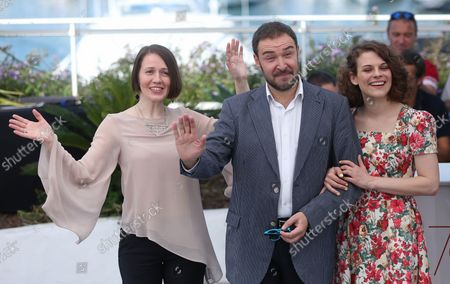 """Olga Dragunova (L), Artem Tsypin (C) and Darya Zhovner arrive at a photocall for the film """"Tesnota"""" during the 70th annual Cannes International Film Festival in Cannes, France on May 24, 2017."""