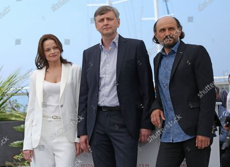 """Vasilina Makovtseva (L), Sergei Loznitsa (C) and Valeriu Andriuta arrive at a photocall for the film """"Krotkaya (A Gentle Creature)"""" during the 70th annual Cannes International Film Festival in Cannes, France on May 25, 2017."""