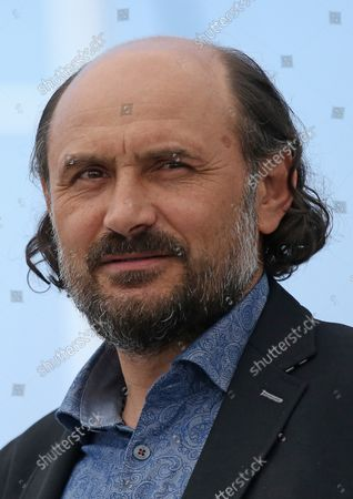 """Stock Picture of Valeriu Andriuta arrives at a photocall for the film """"Krotkaya (A Gentle Creature)"""" during the 70th annual Cannes International Film Festival in Cannes, France on May 25, 2017."""